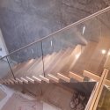 Spinebeam Staircase with frameless glass
